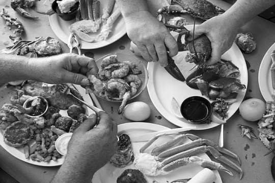 eating a seafood dinner